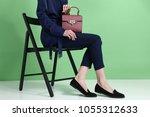 model holds fashion handbag on... | Shutterstock . vector #1055312633