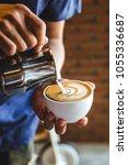 coffee cup latte art | Shutterstock . vector #1055336687