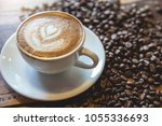 a cup of coffee with heart... | Shutterstock . vector #1055336693