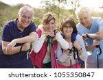 portrait of happy senior couple ...   Shutterstock . vector #1055350847