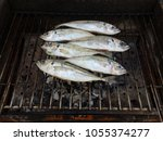 grilled mackerel fish over the...   Shutterstock . vector #1055374277