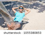 vacation concept. enjoying the... | Shutterstock . vector #1055380853