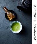 cup of matcha green tea on dark ...   Shutterstock . vector #1055386103