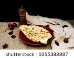 traditional indian naan garlic...   Shutterstock . vector #1055388887