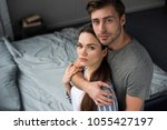 young man embracing his...   Shutterstock . vector #1055427197