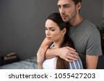 beautiful couple tenderly... | Shutterstock . vector #1055427203