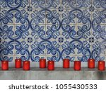 red firing candles in catholic...   Shutterstock . vector #1055430533