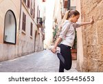 young woman exercising in city... | Shutterstock . vector #1055445653