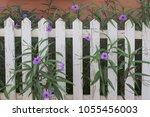 white fence in vintage look... | Shutterstock . vector #1055456003