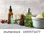 composition with bottles of... | Shutterstock . vector #1055571677