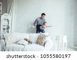 loving father plays with his... | Shutterstock . vector #1055580197