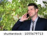 the young manager is calling | Shutterstock . vector #1055679713