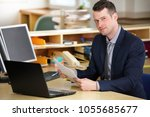 a young  manager working on a... | Shutterstock . vector #1055685677