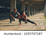 young couple stretching legs in ... | Shutterstock . vector #1055707187