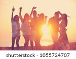 group of young people enjoy... | Shutterstock . vector #1055724707