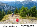 tourists on a hiking trails of... | Shutterstock . vector #1055728877