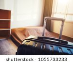 the black suitcase in an... | Shutterstock . vector #1055733233