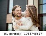 young millennial couple... | Shutterstock . vector #1055745617