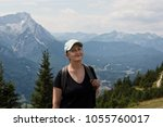 older woman hiking in the...   Shutterstock . vector #1055760017