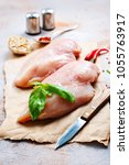 Small photo of raw chicken fillet with spice and salt. chicken fillet on board, stock photo