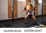 fit young woman in exercise... | Shutterstock . vector #1055814047
