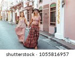 boho mom with daughter in maxi... | Shutterstock . vector #1055816957