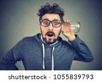 funny surprised man in glasses... | Shutterstock . vector #1055839793