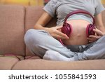 pregnant woman sitting on a... | Shutterstock . vector #1055841593