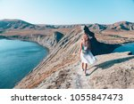 girl walking on the mountain... | Shutterstock . vector #1055847473