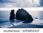black dark rock eroded cliff... | Shutterstock . vector #1055852417