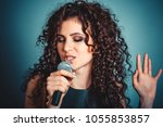 singer. closeup portrait head... | Shutterstock . vector #1055853857