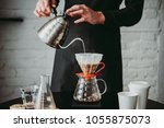 making pour over coffee with a... | Shutterstock . vector #1055875073