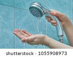 female hands hold a new shower... | Shutterstock . vector #1055908973