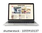 business news website on laptop.... | Shutterstock . vector #1055910137