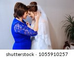 mother and her daughter the... | Shutterstock . vector #1055910257
