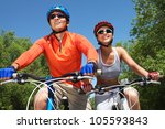 young smiling couple cycling...   Shutterstock . vector #105593843