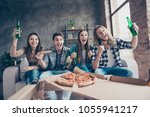 Small photo of Yes, yeah, hooray! Cheerful jouful screaming yelling four soccer fans having day-off resting eating takeaway pizza and drinking beer