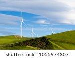 wind turbines on the hills of... | Shutterstock . vector #1055974307