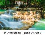 beautiful erawan waterfall ... | Shutterstock . vector #1055997053