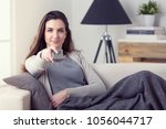 portrait of young woman laying... | Shutterstock . vector #1056044717
