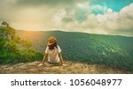 young traveling woman wearing... | Shutterstock . vector #1056048977