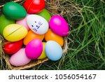 row of easter eggs in fresh... | Shutterstock . vector #1056054167