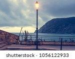 street lamp lantern turned on... | Shutterstock . vector #1056122933