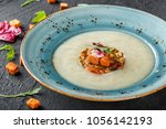 cream soup of celery with... | Shutterstock . vector #1056142193