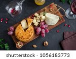 cheese platter with assorted... | Shutterstock . vector #1056183773