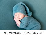 infant baby boy sleeping in... | Shutterstock . vector #1056232703