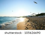 Beach and Mediterranean sea in a summer day, Cannes, France - stock photo