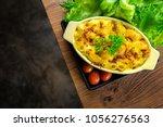 macaroni and cheese homemade... | Shutterstock . vector #1056276563