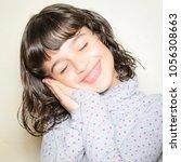 portrait of smiling girl   Shutterstock . vector #1056308663
