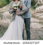 a marrige couple bride and... | Shutterstock . vector #1056327107